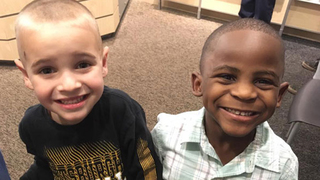 Boy shaves his head to look like his best friend