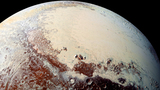 "This high-resolution image captured by NASA's New Horizons spacecraft shows the bright expanse of the western lobe of Pluto's ""heart,"" or Sputnik Planitia, which is rich in nitrogen, carbon monoxide and methane ices."
