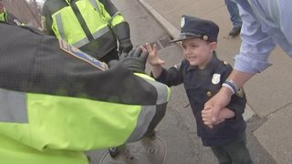 4-year-old with brain tumor gets star treatment as honorary police officer