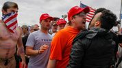 A scuffle breaks out between Pro-Trump and Anti-Trump protesters during Make America Great Again March on March 25, 2017, in Huntington Beach, California.