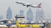 Planes take off from Hartsfield-Jackson International Airport.