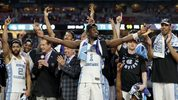 North Carolina's Theo Pinson (1) and the rest of the team celebrate after the finals of the Final Four NCAA college basketball tournament against Gonzaga, Monday, April 3, 2017, in Glendale, Ariz. North Carolina won 71-65. (AP Photo/David J. Phillip)