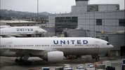 United Airlines planes sit on an airport tarmac. Justin Sullivan/Getty Images