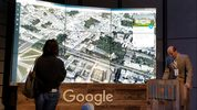 Sean Askay, right, engineering manager with Google Earth, demonstrates features on Google Earth on April 18, 2017, in New York. Google Earth is getting a revival, with the mapping service becoming more of a tool for adventure and exploration.
