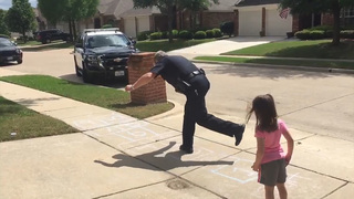 Police officer playing hopscotch with child wins internet