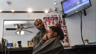 Woman pulls gun, says barber took too long to give son haircut