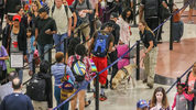 Foot traffic at Hartsfield-Jackson International Airport checkpoints was heavy early Fri., May 27, 2016 before Memorial Day weekend.