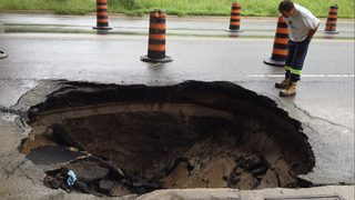 Uber driver mistakes sinkhole for puddle, car plunges into muck