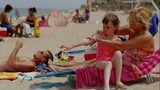 Sharon Doyle puts sunscreen on the arm of 9-year-old Savannah Stidham as they visit the beach June 20, 2006 in Fort Lauderdale, Florida.