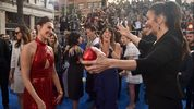 Actors Gal Gadot and Lynda Carter embrace at the premiere of Warner Bros. Pictures'