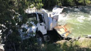 Postal truck crash sends boxes of medical supplies into creek