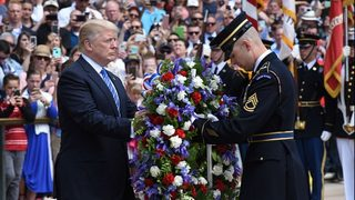President Trump observes Memorial Day with somber service at Arlington