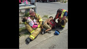 Amarillo, Texas, firefighters Sam Berry and Jared Davis comfort two children involved in a car crash. The photo, shared on the fire department's Facebook page Monday, June 12, 2017, soon went viral.