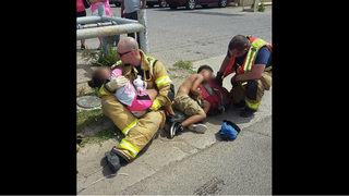 Viral photo shows firefighters holding, comforting children involved in…