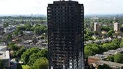The remains of Grenfell Tower, a residential tower block in west London which was gutted by fire, are pictured against the London skyline on Friday.