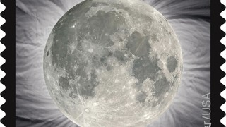 Solar Eclipse Stamp Changes from Eclipsed Sun to Full Moon