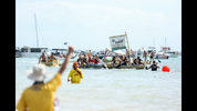 Boats compete in the Beer Can boat race during the Darwin Beer Can Regatta at Mindil Beach on July 9, 2017 in Darwin, Australia. The annual event first started in 1974 as a way to clean up beer cans littering local streets.