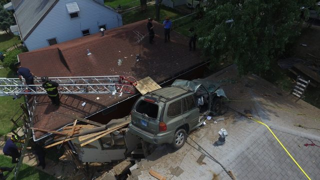 Speeding Driver Goes Airborne Lands Suv On House Roof Officials