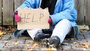 Homeless woman (stock photo).