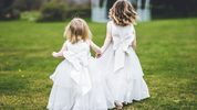 Two tiny flower girls from a wedding (stock photo). James Brokensha Photography/Getty Images