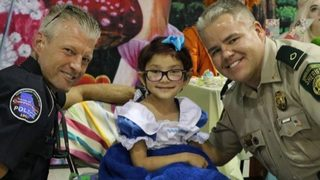 Georgia Law enforcement officers surprise young girl with cancer