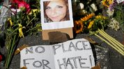 A makeshift memorial of flowers and a photo of victim, Heather Heyer, sits in Charlottesville, Va., Sunday, Aug. 13, 2017. Heyer died when a car rammed into a group protesting against white supremacists who had gathered in the city for a rally.