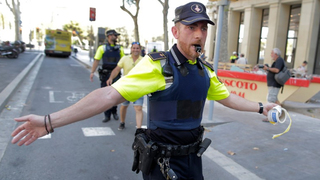 Death toll in Spain attacks rises to 14, police say