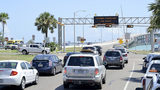 A Texas Department of Transportation message board warns drivers to the development of Harvey on Wednesday, Aug. 23, 2017, in Port Isabel, Texas. (Jason Hoekema/The Brownsville Herald via AP)