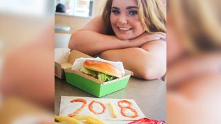 Teen Poses At Favorite Restaurant For Senior Photos