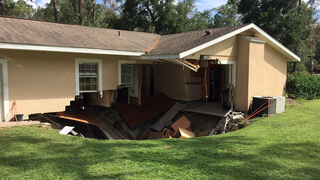 Florida home partially swallowed by sinkhole