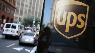 Woman watched dogs attack UPS driver, threatened to shoot him, police say