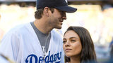 Ashton Kutcher (L) and Mila Kunis attend game 4 of the NLCS between the Chicago Cubs and the Los Angeles Dodgers at Dodger Stadium on October 19, 2016 in Los Angeles, California.