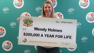 Woman wins $200,000 a year for life with scratch-off game