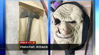 Masked man uses hatchet to attack man on lawnmower
