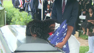 Funeral held for soldier at center of Trump rift