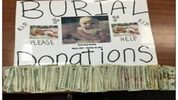 A sign soliciting donations for burial donations was allegedly used by two women arrested on dead baby scam charges.