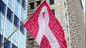A breast cancer awareness flag, flies outside the Borg Warner Building in Chicago in 2013. Raymond Boyd/Getty Images