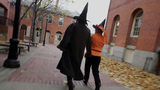 Costumed people dressed as witches walk though the street next to the old Town Hall as they visit the town where, back in 1692, witch trials took place, October 27, 2005 in Salem, Massachusetts.