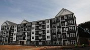 New housing stands at Canal Crossing, a luxury apartment community consisting of 393 rental units near the university city of New Haven on August 2, 2017 in Hamden, Connecticut.