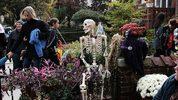 FILE PHOTO:People trick-or-treat in a Brooklyn neighborhood on Halloween night.