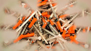 Used syringes. LUIS ROBAYO/AFP/Getty Images