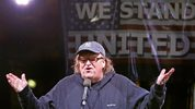 File- This Jan. 19, 2017, file photo shows filmmaker Michael Moore speaking to thousands of people at an anti-Trump rally and protest in front of the Trump International Hotel in New York. (AP Photo/Kathy Willens. File)
