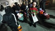 Kids dressed in their Halloween costumes get ready to trick or treat.