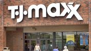 Shoppers are seen walking in front of a T.J. Maxx store.
