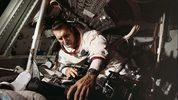 Captain Richard Gordon works on equipment of the Apollo 12 command module, in preparation for the November 14, 1969, mission.