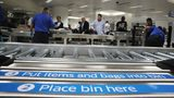 MIAMI, FL - OCTOBER 24: Travelers use the automated screening lanes funded by American Airlines and installed by the Transportation Security Administration at Miami International Airport on October 24, 2017 in Miami, Florida.