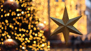 A star hangs near a Christmas tree during Christmas shopping season in a shopping mall on December 8, 2012 in Berlin, Germany. (Adam Berry/Getty Images)