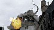 This June 19, 2014 file photo shows a dragon breathing fire from atop Gringnotts Bank during in Diagon Alley at the Wizarding World of Harry Potter at Universal Orlando, in Orlando, Fla.
