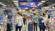 Shoppers shop in a Toys R Us store on Black Friday, Nov. 25, 2016, in Miami. Stores open their doors Friday for what is still one of the busiest days of the year, even as the start of the holiday season edges ever earlier. (AP Photo/Alan Diaz)