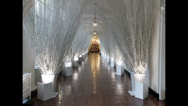 the east colonnade of the white house decorated for christmas